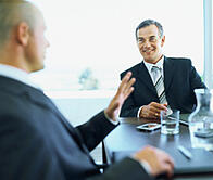 A business broker from New Jersey in a meeting